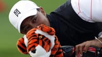 Tiger Woods playfully peeks out from behind a head cover in Tuesday's practice round at the Abu Dhabi Golf Club in the UAB. (Ross Kinnaird/Getty Images)