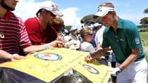 Luke Donald, right, signs autographs prior to a PGA Championship practice round on the Ocean Course in Kiawah Island, S.C.  (Andrew Redington/Getty Images)