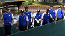 Paul Lawrie, left to right, Francesco Molinari, Nicolas Colsaerts and Lee Westwood of Europe cross a bridge with their caddies during a practice round at Medinah Country Golf Club in Medinah, Ill., on Wednesday. (Ross Kinnaird/Getty Images)