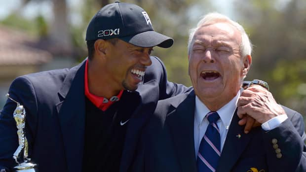 Tiger Woods, left, shares a laugh with golf legend Arnold Palmer during the trophy presentation after he won his eighth Arnold Palmer Invitational title on Monday in Orlando, Fla. (Phelan M. Ebenhack/Associated Press)
