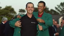As the previous year's champion, Tiger Woods, right, put the green jacket on Mike Weir after the Canadian's victory at Augusta in 2003. (Harry How/Getty Images)
