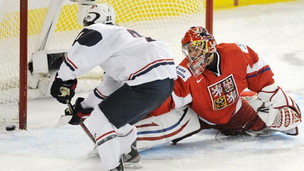 Czech Republic goalie Petr Mrazek makes a save against the penalty shot from team USA's Josh Archibald, right, during the third period on Friday. (John Ulan/Canadian Press)