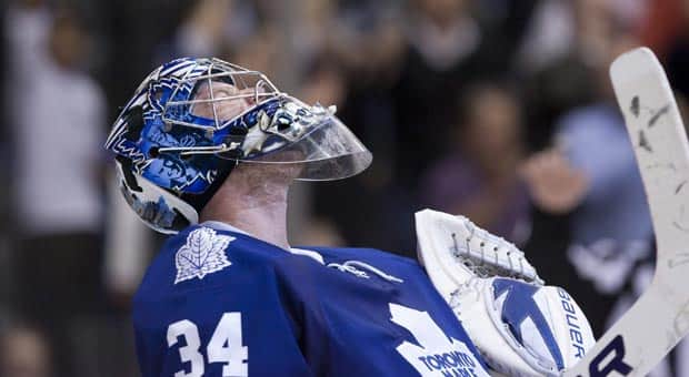 Toronto Maple Leafs goaltender James Reimer celebrates his team's 3-2 win over Buffalo Sabres at the final buzzer in Toronto on Thursday. (Chris Young/Canadian Press)