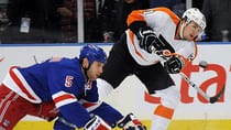 Dan Girardi of the New York Rangers and Braydon Coburn of the Philadelphia Flyers, seen battling in a game last week, will meet again outdoors. (Henry Lee Abrams/Associated Press)