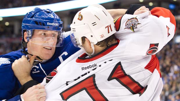 Toronto Maple Leafs Dion Phaneuf, left and Ottawa Senators Nick Foligno fight during the second period in Toronto. The fight followed a hit by Foligno that forced Phaneuf to leave the game for a short time. (Fred Thornhill/Reuters)