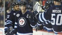 The Winnipeg Jets' resurgence has been sparked by players like Andrew Ladd, centre, and his teammates chipping in at different times. (Tom Szczerbowski/Getty Images)