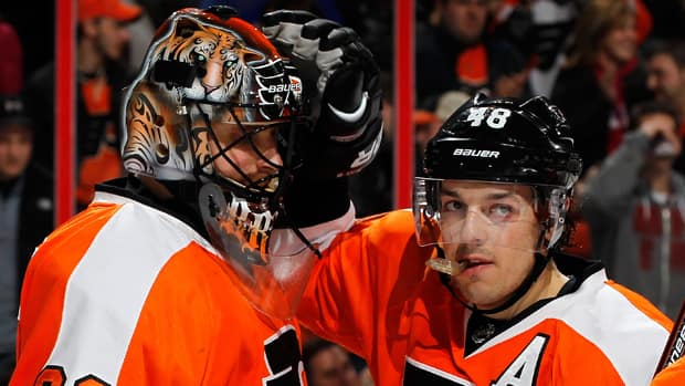 Philadelphia Flyers goalie Ilya Bryzgalov, shown at left in this file photo being congratulated by teammate Danny Briere, has certainly got his game back on track after a tumultuous mid-season drop in production. (Paul Bereswill/Getty Images)