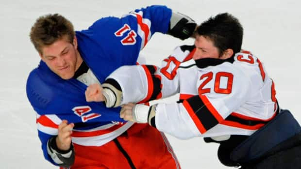 New Jersey Devils' Ryan Carter, right, fights with New York Rangers' Stu Bickel during the first period on Monday at Madison Square Garden in New York. It was just one of three fights that happened three seconds into the contest. (Bill Kostroun/Associated Press)