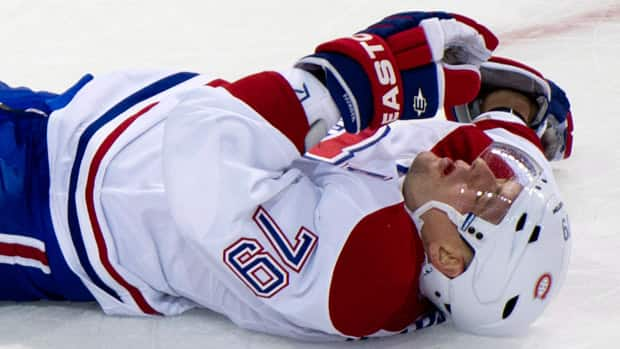 Montreal Canadiens defenceman Andrei Markov lies on the ice after taking a puck in the face during a game against the Ottawa Senators on Wednesday in Montreal. (Paul Chiasson/Canadian Press)