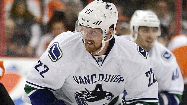 Daniel Sedin of Vancouver could be out longer than the five games that Duncan Keith of Chicago will have to serve as suspension. (Tom Mihalek/Associated Press)