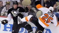 Pittsburgh Penguins' Jordan Staal (11) collides with Philadelphia Flyers' Matt Carle (25) during Game 2 on Friday. (Gene J. Puskar/Associated Press)
