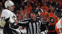Linesman Tony Sericolo separates Evgeni Malkin (71) of the Pittsburgh Penguins and Scott Hartnell (19) of the Philadelphia Flyers on Feb. 18 in Philadelphia. (Bruce Bennett/Getty Images)