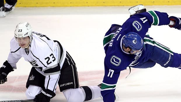 Ryan Kesler of Vancouver, sent flying on a Game 1 play as Kings captain Dustin Brown looks on, is under pressure to put forth a better performance. (Darryl Dyck/Canadian Press)