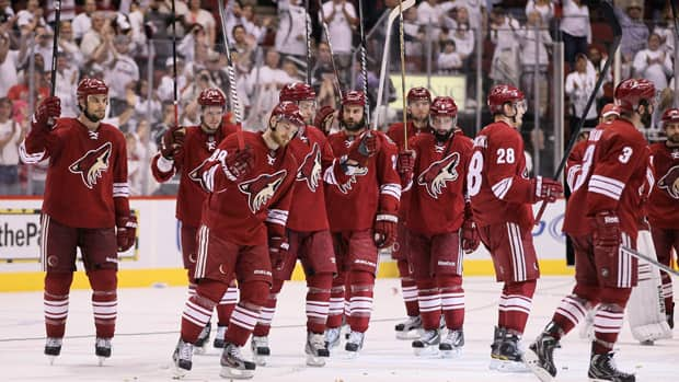 The Phoenix Coyotes salute the crowd after being eliminated from the playoffs in their 4-3 overtime loss to the Los Angeles Kings in Game 5 on Tuesday in Glendale, Arizona.  (Jeff Gross/Getty Images)