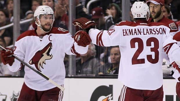 Veteran winger Shane Doan, left, score both goals Sunday for the Coyotes, who avoided a sweep at the hands of the Los Angeles Kings. (Jeff Gross/Getty Images)