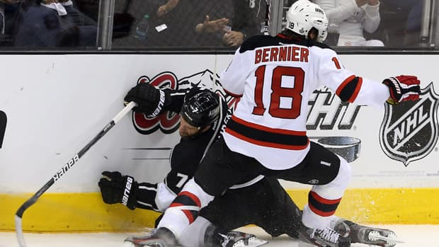 Steve Bernier (18) of the New Jersey Devils boards Rob Scuderi (7) of the Los Angeles Kings in the first period of Game 6 on Monday in Los Angeles, California. Bernier received a five-minute major and a game misconduct. (Bruce Bennett/Getty Images)