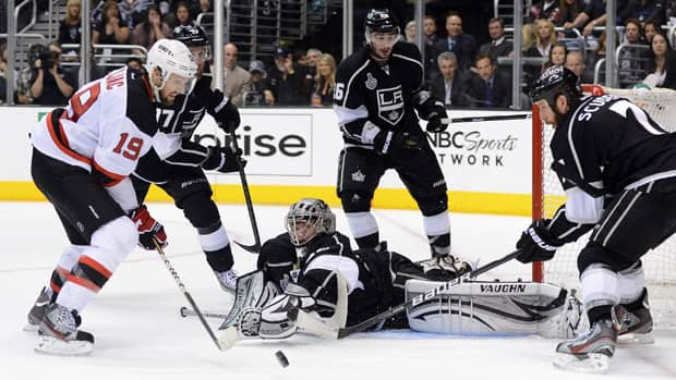 Jonathan Quick (32) of the Los Angeles Kings defends his net as Travis Zajac (19) of the New Jersey Devils looks to put a shot on net in Game 3 on Monday in Los Angeles. (Harry How/Getty Images)