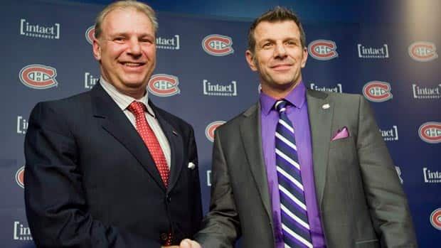 Montreal general manager Marc Bergevin, right, welcomes back Michel Therrien as head coach of the Canadiens. (Graham Hughes/Canadian Press)