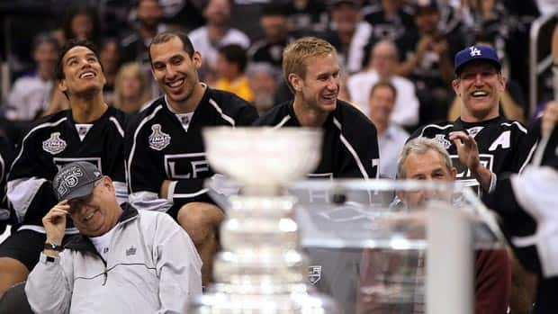 Jack Ferreira, bottom left, shares a laugh with Los Angeles Kings players and coaches during last week's celebration at Staples Center. (Victor Decolongon/Getty Images)