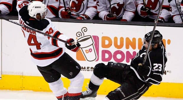 Bryce Salvador of New Jersey and Los Angeles captain Dustin Brown collide in Game 4, which saw the Devils stay alive. (Jae C. Hong/Associated Press)