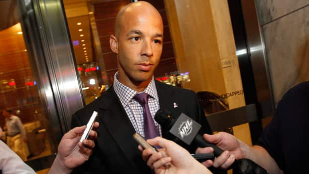 NHL forward Manny Malhotra, seen talking to reporters in July in New York, has expressed frustration with how revenue is being calculated. (Jason DeCrow/Associated Press)