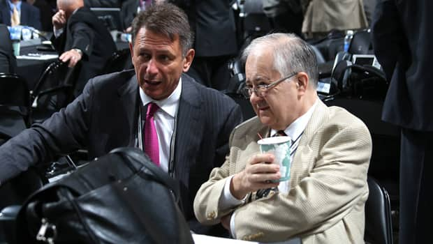 Red Wings senior vice-president Jim Devellano, right, confers with general manager Ken Holland at the NHL draft on June 23. (Bruce Bennett/Getty Images)