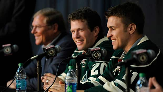 Minnesota Wild owner Craig Leipold, left, looks on as Zach Parise, right, and Ryan Suter speak during their first press conference as members of the team after signing identical lucrative contracts. Do you think Leipold made the right decision to sign the duo or did he overpay? (Hannah Foslien/Getty Images)