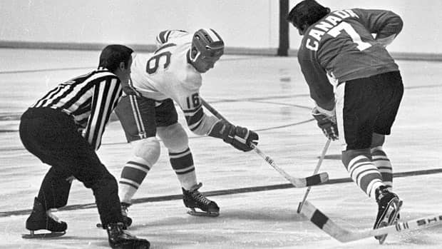Team USSR's Vladimir Petrov and Team Canada's Phil Esposito face-off during the 1972 Summit Series. A rant by Esposito after Game 4 proved to be one of the most important moments in the series. (Peter Bregg/Canadian Press)