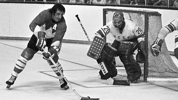 Phil Esposito tries a backhand shot in Game Three of the Summit Series against Vladislav Tretiak.  His interview with Johnny Esaw  after Game Four is one of Canada's iconic hockey moments.  (Canadian Press/Peter Bregg)