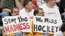 It may be a different time but hockey fans, like these two in 2005, remain opposed to any kind of NHL work stoppage.  (Brian Bahr/Getty Images)