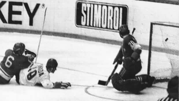 Paul Henderson, while on the ground, drives the puck past the Soviet Union's goalie Vladislav Tretiak in Game 7 for the second of his game-winning goals in the 1972 Summit Series. (CP Archive)