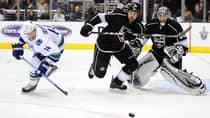 Had the season started on time, Alex Burrows (14) and the Canucks might have topped the Kings in the Western Conference. (Harry How/Getty Images)