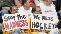 NHL fans, like these two during the 2005 lockout, have been affected by the current work stoppage in various ways. (Brian Bahr/Getty Images)