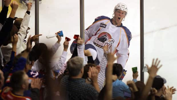 Norfolk Admirals forward Peter Holland whoops it up with fans upon scoring in a 4-2 win over the Worcester Sharks on Oct. 12. (Vicki Cronis/Associated Press)