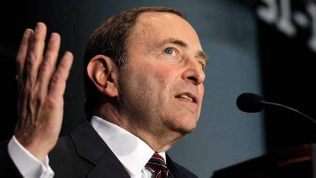 One fan thinks NHL commissioner Gary Bettman, shown speaking during a press conference on Wednesday, would be better served to be sequestered in a tiny negotiating room with NHLPA executive director Donald Fehr until a deal is reached. (Kathy Willens/Associated Press)