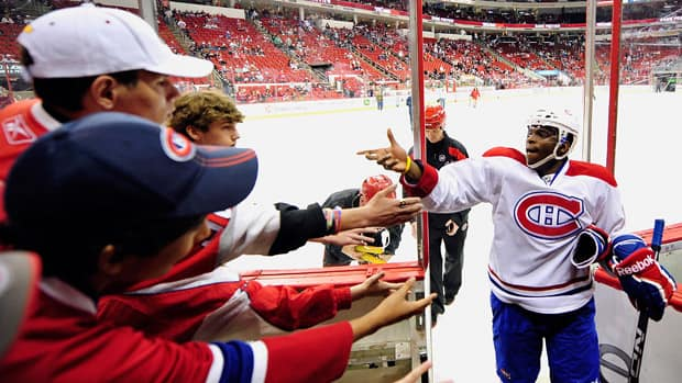 Montreal Canadiens defenceman P.K. Subban tosses a puck to fans before a game in April.(Grant Halverson/Getty Images)