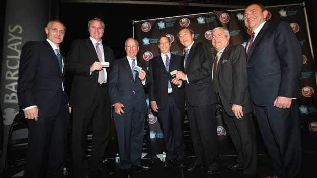 Brooklyn Nets CEO Brett Yormark, New York Islanders general manager Garth Snow, Mayor Michael Bloomberg, Brooklyn Nets owner Bruce Ratner, Islanders owner Charles Wang, Brooklyn Borough President Marty Markowitz and NHL commissioner Gary Bettman gather to announce the New York Islanders move to Brooklyn in 2015 at the Barclays Center on Wednesday in the Brooklyn borough of New York City. (Bruce Bennett/Getty Images)