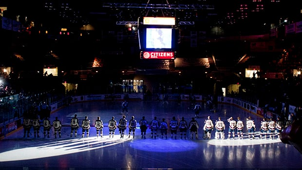 In this photo, the Saginaw Spirit team is introduced at its home opener against the Sudbury Wolves in an OHL hockey game in Saginaw, Mich. (Jon Garcia/Canadian Press)