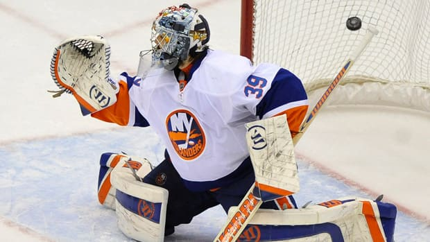 One fan believes owners should take responsibility for bad contracts, like the one the Islanders handed goaltender Rick DiPietro in 2006. (Kathy Kmonicek/Associated Press)