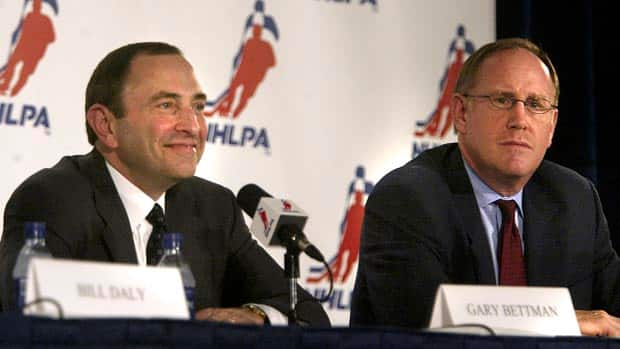 It was July 21, 2005 when NHL Commissioner Gary Bettman  and NHLPA Executive Director Bob Goodenow officially announced an agreement.  And now there is another dispute that has led to no games.  (Tom Pidgeon/Getty Images)