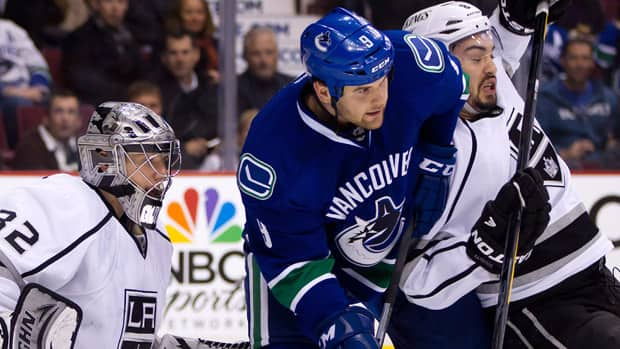 The Vancouver Canucks believe winger Zack Kassian, centre, has the physical presence to be an offensive force.  (Darrly Dyck/Canadian Press)