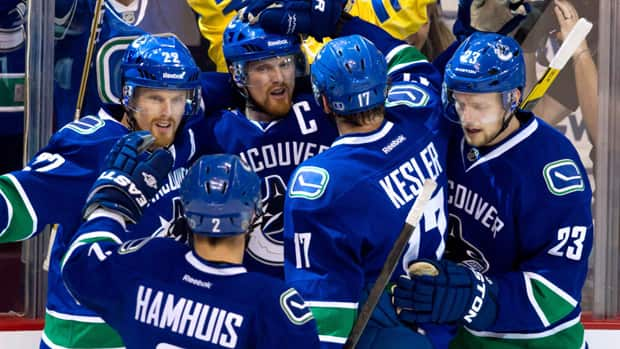 To one NHL fan, the cancellation of games means missing out on watching the Vancouver Canucks. (Darryl Dyck/Canadian Press)