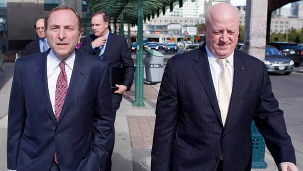 NHL commissioner Gary Bettman, left, arrives with deputy commissioner Bill Daly for collective bargaining talks in Toronto last month. (Chris Young/Canadian Press)