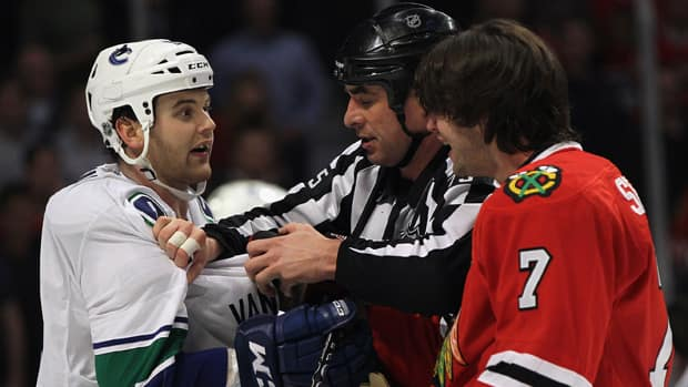 Zack Kassian, shown here in this file photo chirping with the Blackhawks' Brent Seabrook, right, has shown a mean streak in his time with the Chicago Wolves of the AHL, picking up 40 penalty minutes in 16 games. (File/Getty Images)