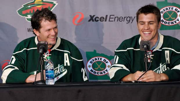 The megabucks contracts signed in the summer by new Minnesota Wild members Ryan Suter, left, and Zach Parise are among the pacts affecting the tenor of the NHL negotiations. (Jim Mone/Associated Press)