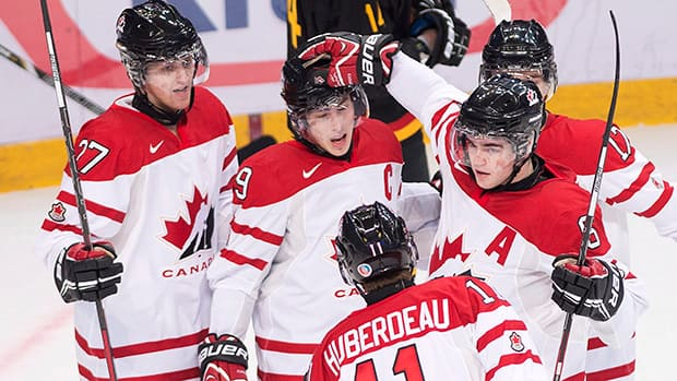 Canada captain Ryan Nugent-Hopkins, centre, celebrates his goal with teammates while playing against Germany during first period IIHF World Junior Championships hockey action in Ufa, Russia on Boxing Day. (Nathan Denette/Canadian Press)