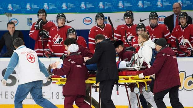 Slovakia forward Patrik Luza leaves the ice on a stretcher after taking a hit from Canada forward Anthony Camara, during second period IIHF World Junior Championships hockey action in Ufa, Russia. (Nathan Denette/Canadian Press)