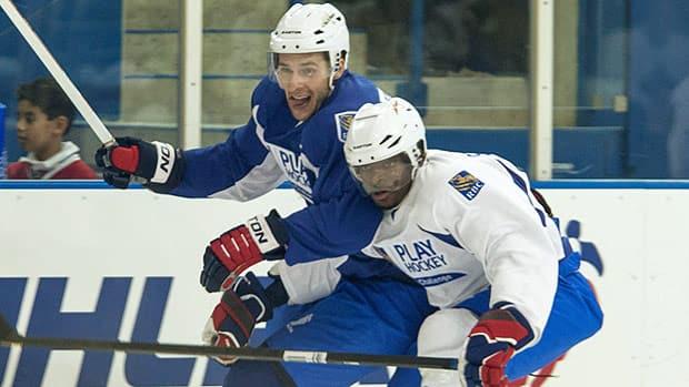 NHLers Wojtek Wolski, left, and PK Subban battle during the RBC charity hockey game in Toronto on Wednesday. (Jesse Johnston/Canadian Press)