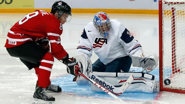 While Canada's Ty Rattie, left, and American goalie John Gibson, right, may not be junior hockey teammates, they will be facing many familiar faces on Thursday when the two squads meet in the semis. (Mark Blinch/Reuters)