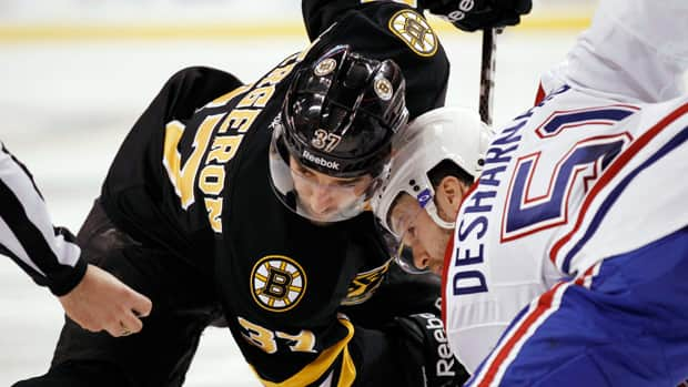 With the players and owners agreeing to end the lockout, when will we see players (and rivalries like the Habs and Bruins) back on the ice? (File/Associated Press)